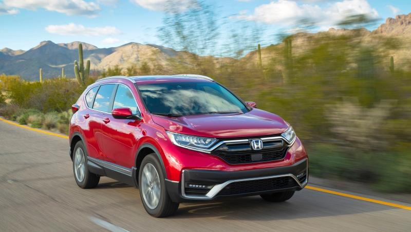 This photo provided by Honda shows a 2021 Honda CR-V Hybrid, an all-wheel-drive hybrid crossover SUV. (American Honda Motor Co. via AP)