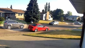 Edmonton police are looking for the black Jeep Cherokee and grey Honda Accord highlighted in this picture from a surveillance camera. (Source: EPS)