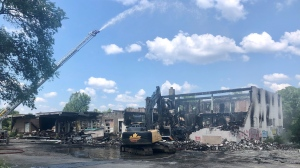 Damage to a building on Centre Street in London, Ont. is seen Wednesday, Aug. 4, 2021, the day after the fire. (Jim Knight / CTV News)