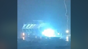 This still image taken from video shows a bolt of lightning hitting Commonwealth Stadium in Edmonton.