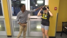 Simba Nyazika and Kirsten Chamberlain demonstrate the Peak Cognition training app using a VR headset and cellphone. (CTV News Edmonton)