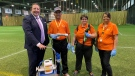 Tim Reid, President and CEO of Regina Exhibition Association with members of the REAL cleaning staff and their sanitizing equipment.