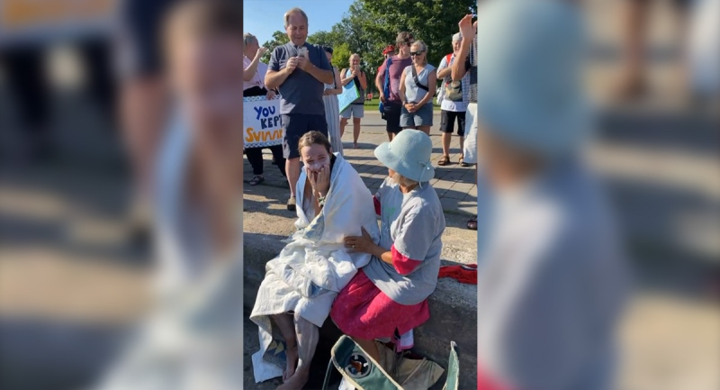 Jillian Best, a transplant survivor, is greeted by supporters after swimming across Lake Ontario and arriving in Toronto on Wednesday, Aug. 4, 2021. (Source: Move for Life Foundation / Facebook)