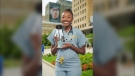 Dr. Chika Stacy Oriuwa is seen holding her Barbie likeness in Toronto's discovery district in an undated handout photo. THE CANADIAN PRESS/HO-Visual Bass, Tobias Wang