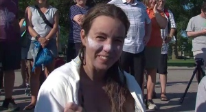 Jillian Best speaks in Toronto after completing her swim across Lake Ontario, Wednesday, Aug. 4, 2021. (CTV News)