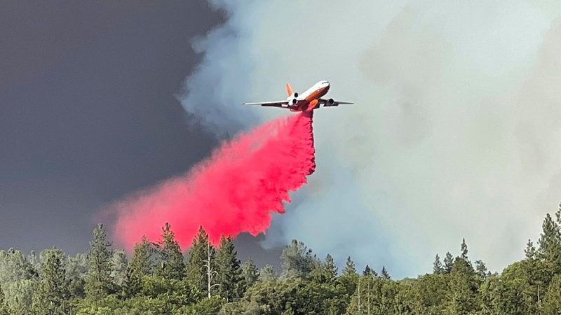 An air tanker makes a retardant drop over a flank of the River Fire Wednesday, Aug. 4, 2021 near Taylor Crossing Road in Nevada County, Calif. (Elias Funez/The Union via AP)