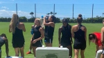Members of the Canada women's Olympic soccer team take a break during their practice the 2020 Summer Olympics, Aug. 5, 2021, in Tokyo, Japan. THE CANADIAN PRESS/Gregory Strong