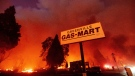 Flames consume buildings as the Dixie Fire tears through the Greenville community of Plumas County, Calif., on Aug. 4, 2021. (Noah Berger / AP)