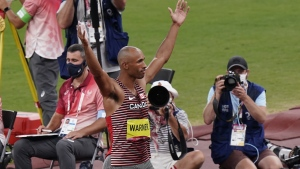 Canada's Damian Warner reacts after his first javelin throw in the decathlon event during the Tokyo Olympics in Tokyo, Japan on Thursday, August 5, 2021. THE CANADIAN PRESS/Adrian Wyld