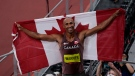 Canada's Damian Warner celebrates his gold medal win in men's decathlon during the Tokyo Olympics in Japan, August 5, 2021. THE CANADIAN PRESS/Adrian Wyld