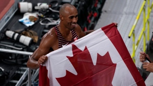 Canada's Damian Warner celebrates his gold medal win in men's decathlon during the Tokyo Olympics in Tokyo, Japan on Thursday, August 5, 2021. THE CANADIAN PRESS/Adrian Wyld