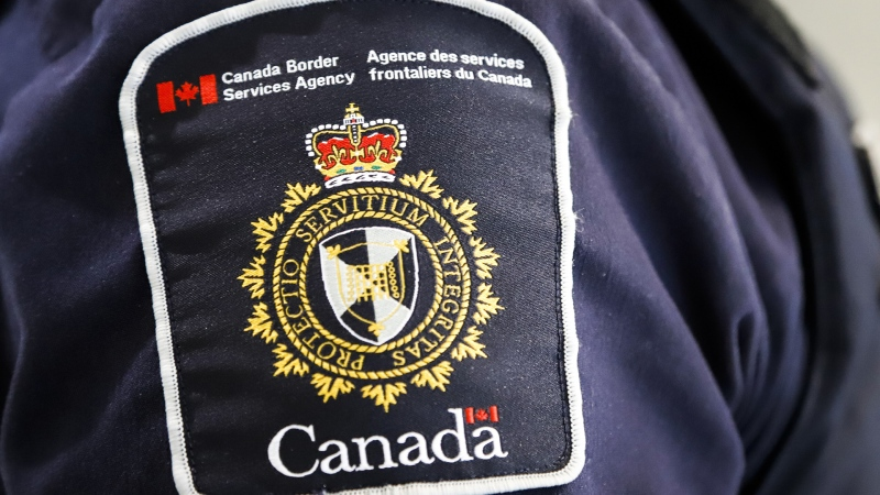 A Canada Border Services Agency (CBSA) patch is seen on an officer in Calgary on August 1, 2019. THE CANADIAN PRESS/Jeff McIntosh