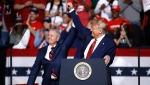 U.S. Sen. Lindsey Graham, R-S.C., left, stands onstage with former President Donald Trump during a campaign rally, Friday, Feb. 28, 2020, in North Charleston, S.C. (AP Photo/Patrick Semansky)