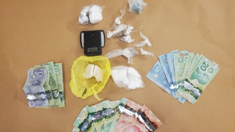 Drugs and cash seized in a raid by London, Ont. police on Aug. 5, 2021. (Supplied)