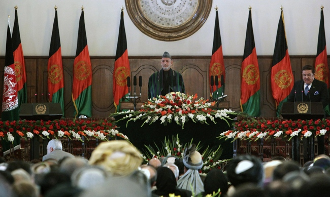 Afghanistan's President Hamid Karzai is applauded after taking the oath during his inauguration as President of Afghanistan at the Presidential Palace in Kabul, Afghanistan, Thursday, Nov. 19, 2009. (AP / Anja Niedringhaus)