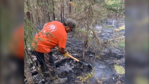 Ron Desjardin, 61, said he had to protect his cabin in a rural part of northern Saskatchewan from a wildfire, using only buckets and a shovel. (Rebecca Sylvestre/Submitted)