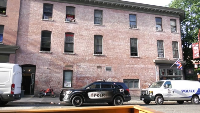 Vancouver police vehicles were parked outside the London Hotel on Main Street on July 20, 2021. (CTV)
