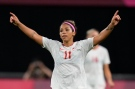 Canada's Desiree Scott celebrates at the end of a women's soccer match against Chile at the 2020 Summer Olympics, Saturday, July 24, 2021, in Sapporo, Japan. Canada won 2-1. (AP Photo/Silvia Izquierdo)