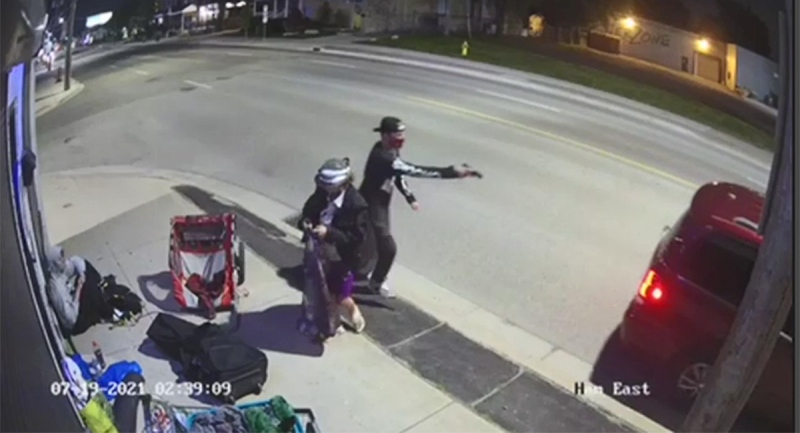 An image taken from surveillance video shows a male with a weapon on Hamilton Road in London, Ont., Monday, July 19, 2021.