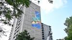 Claudia Salguero's mural being installed on the Ottawa Community Housing Building on Bank Street. (Joel Haslam/CTV News Ottawa)