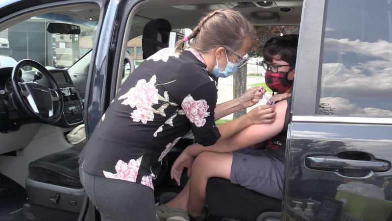 Sandro Fuentes receiving his first vaccine dose on his twelfth birthday at the Sperling Drive Vaccination Clinic in Barrie (Mike Arsalides/CTV News)