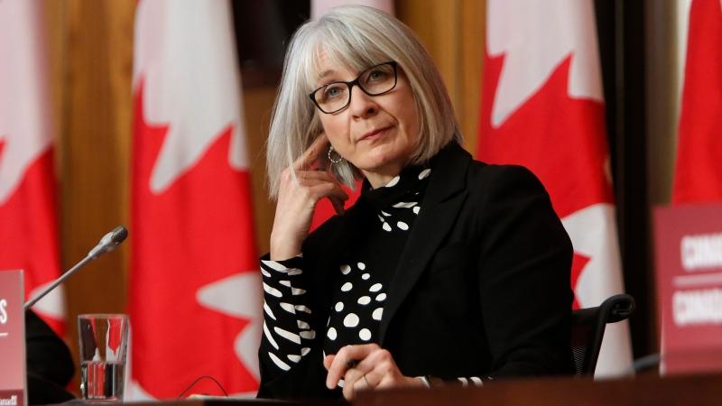 Health Minister Patty Hajdu listens at a COVID-19 press conference in Ottawa on Friday, Dec. 11, 2020. THE CANADIAN PRESS/David Kawai