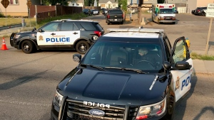 """EPS cruisers and an ambulance can be seen in the Sherbrooke neighbourhood Thursday evening as police respond to an """"ongoing"""" incident (CTV News Edmonton/Sean Amato)"""
