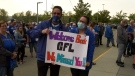 A pair of Winnipeg Blue Bombers' fans happy to see the CFL return after the league missed a season due to the COVID-19 pandemic. Aug. 5, 2021. (Source: Danton Unger/CTV News)