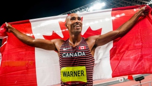 Canadian Damian Warner celebrates after winning gold in the Men's Decathlon during the Tokyo 2020 Olympic Games on Thursday, August 05, 2021. THE CANADIAN PRESS/HO, COC, Mark Blinch