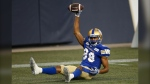 Winnipeg Blue Bombers wide receiver Kenny Lawler (89) celebrates his touchdown against Hamilton Tiger-Cats during first half CFL action in Winnipeg Thursday, August 5, 2021. (THE CANADIAN PRESS/John Woods)