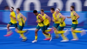 Members of Team Australia warm up before playing Belgium in the gold medal field hockey match at the 2020 Summer Olympics, Aug. 5, 2021, in Tokyo, Japan. (AP Photo/John Locher)