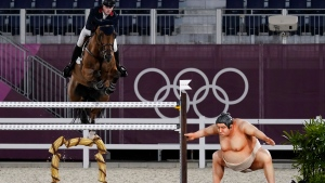 Britain's Harry Charles, riding Romeo 88, competes during the equestrian jumping individual qualifying at Equestrian Park in Tokyo at the 2020 Summer Olympics, Aug. 3, 2021, in Tokyo, Japan. (AP Photo/Carolyn Kaster)