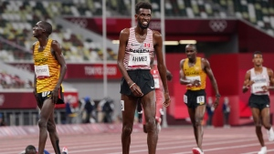 Canada's Moh Ahmed reacts after winning the silver medal in the men's 5000m final during the summer Tokyo Olympics in Japan on August 6, 2021. THE CANADIAN PRESS/Nathan Denette
