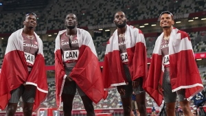 Members of Canada's 4 X100-metre relay team celebrate their bronze medal win during the Tokyo Olympics in Japan on Aug.6, 2021. THE CANADIAN PRESS/Nathan Denette