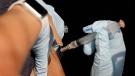 A registered nurse administers a Johnson & Johnson's Janssen COVID-19 vaccine at Iron Gate Wednesday, Aug. 4, 2021 in Tulsa, Okla. (Mike Simons/Tulsa World via AP)
