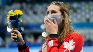 Penny Oleksiak waves her flowers after winning the bronze medal in the women's 200-metre freestyle final at the 2020 Summer Olympics, Wednesday, July 28, 2021, in Tokyo, Japan. (AP Photo/Martin Meissner)