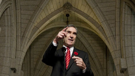 Liberal Leader Michael Ignatieff gestures as he speaks with the media following the party caucus meeting on Parliament Hill in Ottawa, Wednesday Nov.4, 2009. (THE CANADIAN PRESS/Adrian Wyld)