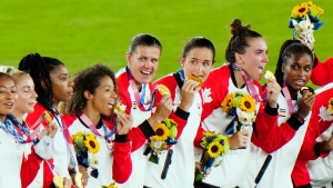 Canada celebrates with their gold medals after defeating Sweden in the penalty shoot-out in the women's soccer final during the summer Tokyo Olympics in Yokohama, Japan on Friday, Aug. 6, 2021. (THE CANADIAN PRESS / Frank Gunn)