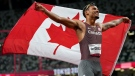 Andre De Grasse, of Canada, celebrates after winning the gold medal in the men's 200-metre final at the 2020 Summer Olympics, Wednesday, Aug. 4, 2021, in Tokyo. (AP Photo/Petr David Josek)