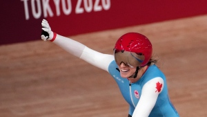 Kelsey Mitchell of Team Canada reacts to winning her heat during the track cycling women's sprint race at the 2020 Summer Olympics, Sunday, Aug. 8, 2021, in Izu, Japan. (AP Photo/Christophe Ena)