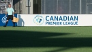 A referee for the Canadian Premier League follows the play down the field during a CPL soccer match at York Lions Stadium in Toronto on Friday, July 30, 2021 (The Canadian Press/Tijana Martin)