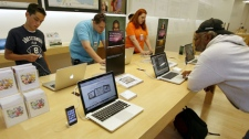 Several customers use the new MacBook Pro laptops at an Apple store in Palo Alto, Calif., Thursday, June 11, 2009. (AP / Tony Avelar)