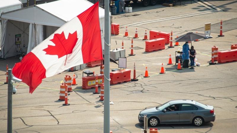 Car cross the border into Canada, in Niagara Falls, Ont., on Monday, August 9, 2021. American citizens and permanent residents are now allowed to enter Canada for non-essential purposes if they can provide proof that they've been fully vaccinated for at least 14 days.THE CANADIAN PRESS/Eduardo Lima