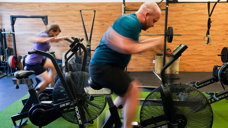 Shauna Fulton, left, and Bryan McSorley work out at Crossfit Bytown as patrons return to the gym as Ontario enters phase 3 of reopening during the COVID-19 pandemic in Ottawa on Friday, July 16, 2021. THE CANADIAN PRESS/Sean Kilpatrick