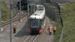 Crews moving an LRT train slowly along the track after a minor derailment earlier in the week. Aug. 11, 2021. (Jim O'Grady / CTV News Ottawa)
