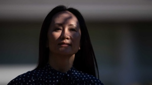 Meng Wanzhou, chief financial officer of Huawei, leaves home to attend her extradition hearing at B.C. Supreme Court, in Vancouver, B.C., Wednesday, Aug. 11, 2021. THE CANADIAN PRESS/Darryl Dyck