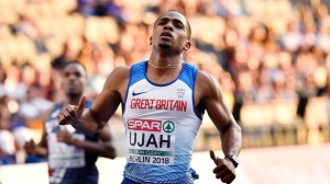 Britain's Chijindu Ujah checks his time after a men's 100-meter semifinal at the European Athletics Championships in Berlin, Germany, Tuesday, Aug. 7, 2018. (AP Photo/Martin Meissner)