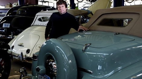 Owner David Grainger poses with some of his restored classic antique cars at The Guild of Automotive Restorers business in Bradford, Ont., on Monday, Nov. 16, 2009. (Nathan Denette / THE CANADIAN PRESS)
