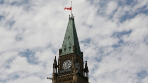 The Canadian flag flies at half-staff on the Peace Tower at Parliament Hill in recognition of the discovery of unmarked indigenous graves at residential schools on Canada Day, Thursday, July 1, 2021. THE CANADIAN PRESS/ Patrick Doyle