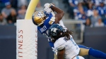 Winnipeg Blue Bombers' Rasheed Bailey (88) makes a catch for a touchdown as Toronto Argonauts' Shaq Richardson defends during the first half of CFL action in Winnipeg Friday, August 13, 2021. (THE CANADIAN PRESS/John Woods)